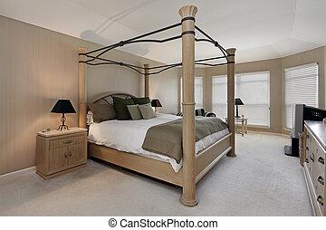 Master bedroom with oak wood bed frame