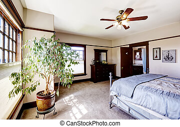 Master bedroom with tree