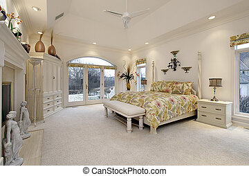 Master bedroom with white fireplace