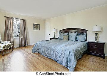 Master bedroom with wood flooring