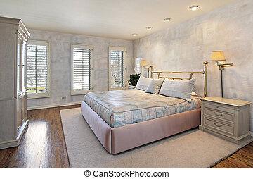 Master bedroom with wood floors