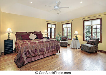 Master bedroom with wood trim windows