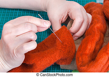 craftsman repairs felted glove with felting needle