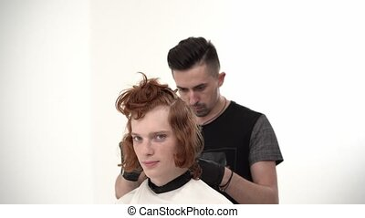 Master Hairdresser Doing Haircut to a Young Guy with Red...