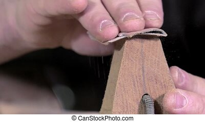 shaping the back of the neck of the guitar