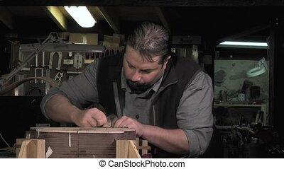 Master luthier guitars at work - surfacing inlaid soundboard...