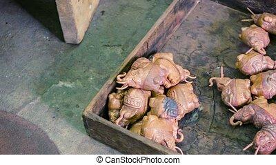 Master makes souvenirs of bronze. Cambodia, Siem Reap -...