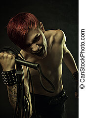 Master of pain - Redhead angry gothic man with lash over...