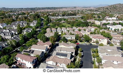 Aerial view of large-scale residential neighborhood with blue sky, Ladera Ranch, South Orange County, California