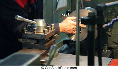 Master sets item on horizontal milling machine in factory....