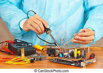 Master solder electronic components of device in service...