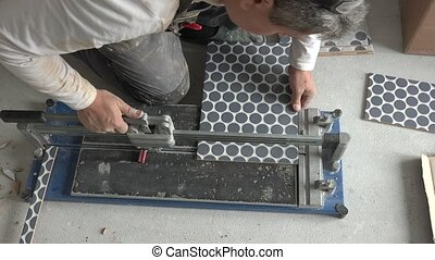 Master worker cut slice tile piece with professional cutter