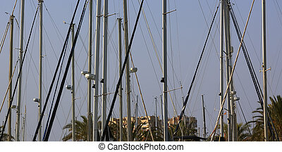 masts of boats with radar system