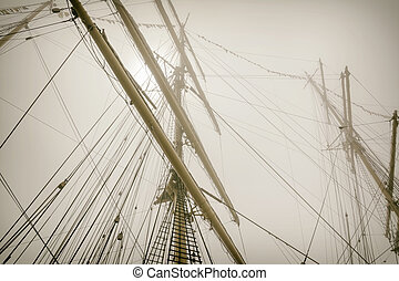 Masts Of Sailboats In The Fog