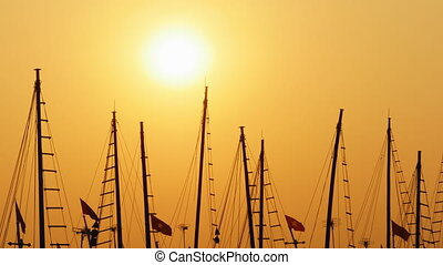 Masts of ships and boats at sunset. Vietnam.