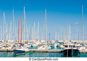 masts of yachts at the marina sea