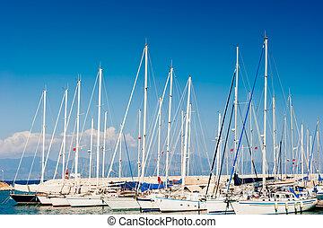 masts of yachts at the marina
