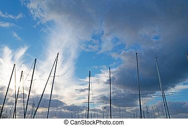 masts under clouds