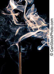 Match burn-out - Single match stick being blown out with a...