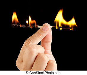 Match burnout - Hand holding a match burning at both ends