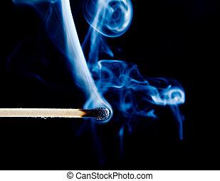 match smoke on a black