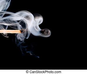 match smoke  - Smoke from a match that was just put out