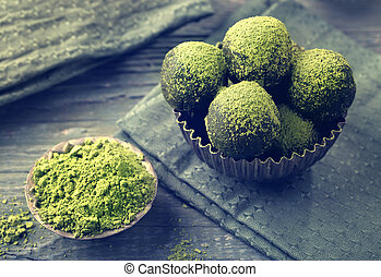 Matcha energy balls dusted with bright green matcha powder