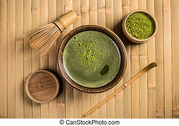 Matcha fine powdered green tea with whisk and spoon