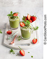 Matcha green tea panna cotta with coconut milk topped with...