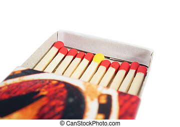 Matchbox with red and yellow matches isolated