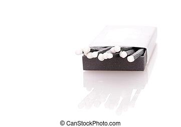 Matchbox with stylish black matches