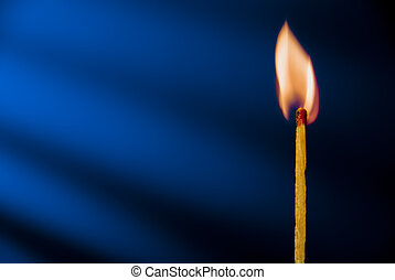 Matchstick - Flame of matchstick against blue background