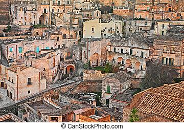 Matera, Basilicata, Italy: view at sunrise of the old town -...