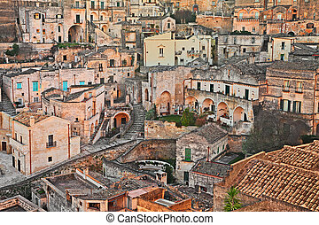 Matera, Basilicata, Italy: view at sunrise of the old town -...