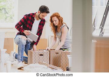 material, casa, caixas, enquanto, embalagem, moving-out, casamento, novo, caixa papelão