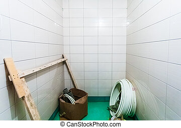Materials for plumbing for repairs bathroom fixtures or bathroom fitment in room with tile an apartment is under construction, remodeling, rebuilding and renovation.