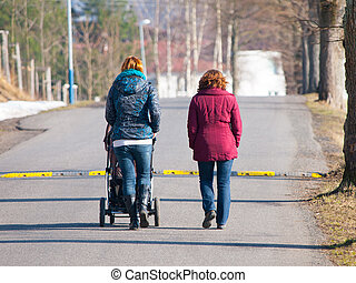 Maternity leave activity - Two women walking towards speed ...