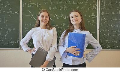 mathématique, école, peint, filles, deux, contre, poser, planche, écolière, formulas., toile de fond