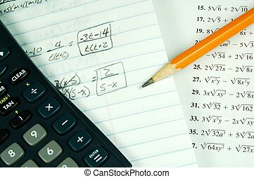 A math book with a calculator and math paper
