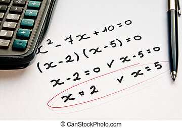 math exercise with calculator and pen