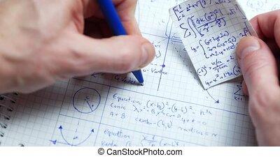 Math handwriting in notebook close up