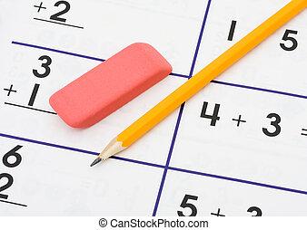 A pencil and an eraser on a math sheet background, math homework