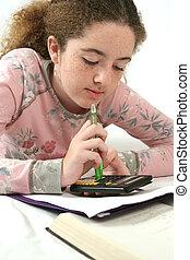 Math Homework - A school girl doing math homework.