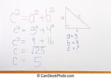 Math problem on whiteboard illustrating pythagorean theorem