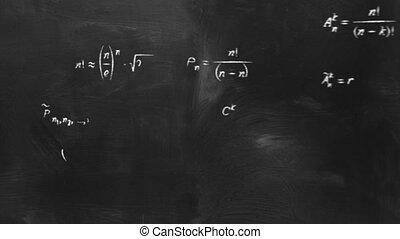 math physics formulas on chalkboard