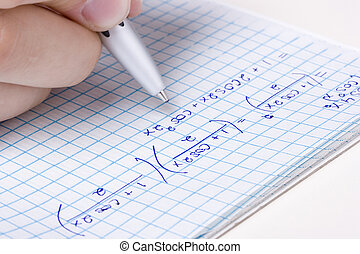 Math - Student solving a math problem in a notebook.