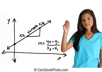 Math Student - Teen girl doing a math problem with black...