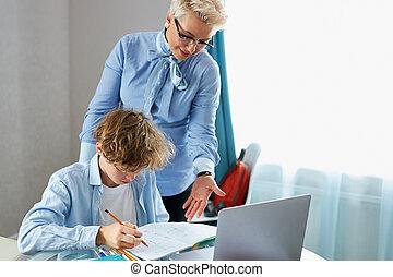 math teacher teach young teen boy at home