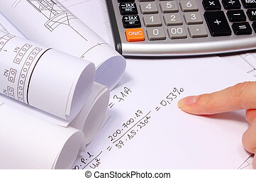 Mathematical calculations, rolled electrical diagrams and calculator