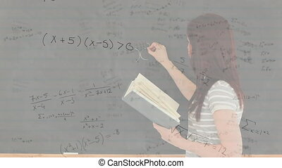 Mathematical equations against teacher writing on blackboard...
